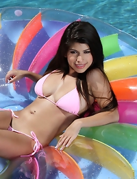 Layla Rose has a body built for sin while floating in the pool